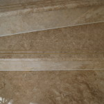 Brown marble steps with full bullnose edge