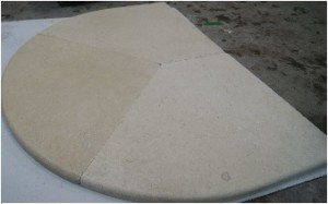 Limestone cut into a circle and with demi-bullnosed edge