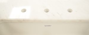 Detail from white marble sink top waterjet cut and bullnosed at Aquacut