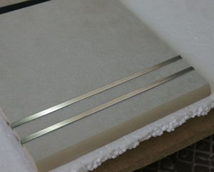 Typical step tile waterjet cut, bullnosed (eased) profile and with stainless steel bars for anti-slip
